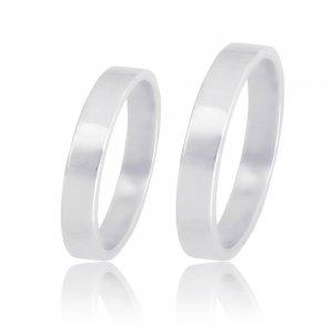 Βέρες γάμου λευκόχρυσες 14Κ σε κλασικό πλακέ σχέδιο, με τετραγωνισμένη επιφάνεια 3 mm σε λουστρέ λαμπερό φινίρισμα. Η αρχική τιμή αναφέρεται σε μία βέρα Νο 10 και μεταβάλλεται ανάλογα με το νούμερό σας.