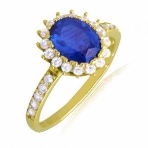 Ροζέτα δαχτυλίδι από χρυσό 14Κ, σε οβάλ σχήμα. Είναι διακοσμημένο με ένα οβάλ μπλε ζιργκόν στο κέντρο και λευκά περιμετρικά.