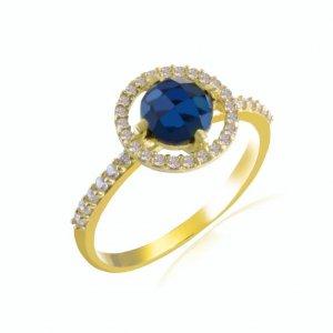 Δαχτυλίδι ροζέτα γυναικείο από χρυσό 14Κ σε στρογγυλό σχήμα. Είναι διακοσμημένο με μπλε ζιργκόν στο κέντρο και λευκά περιμετρικά .