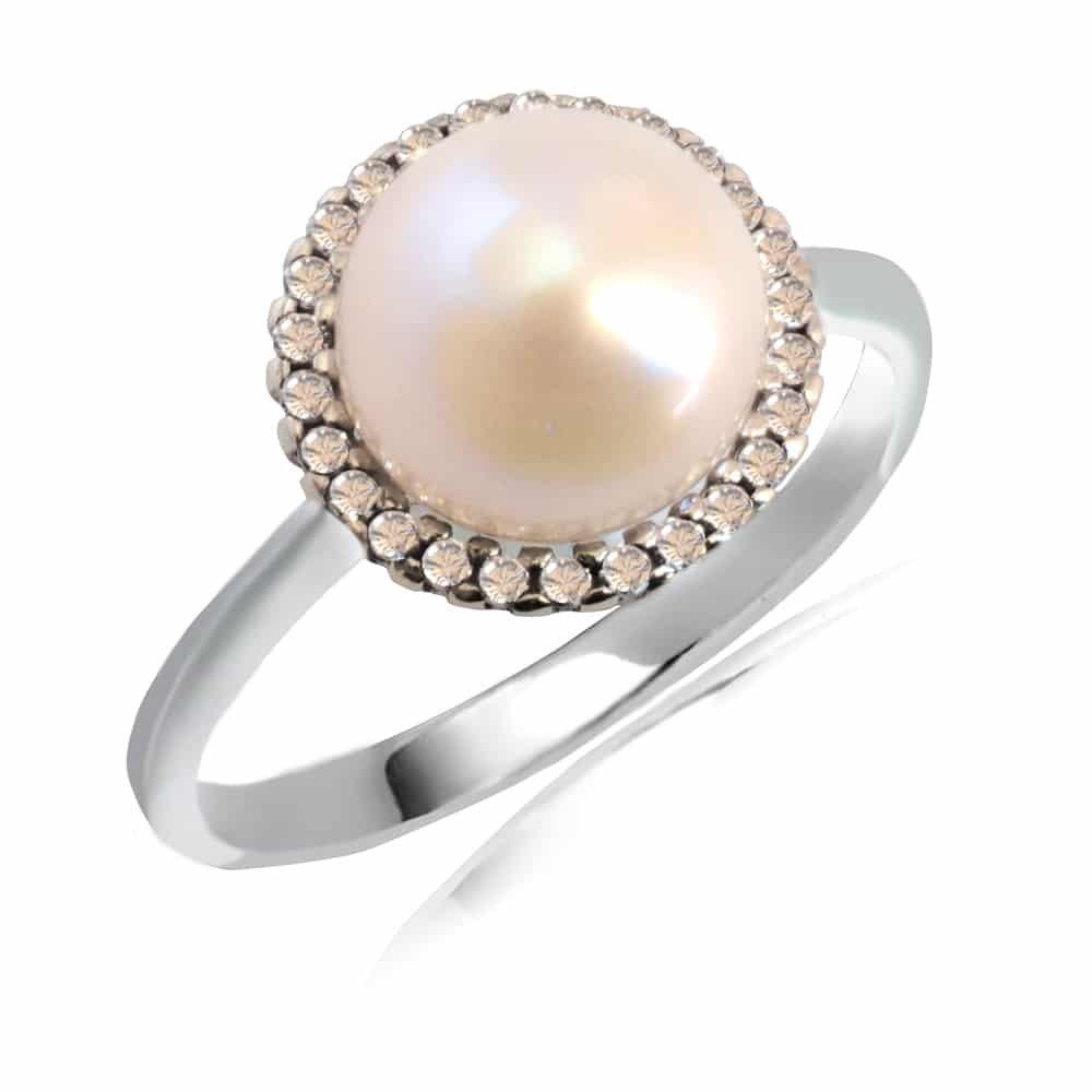 Δαχτυλίδι λευκόχρυσο ροζέτα 14Κ σε στρογγυλό σχήμα. Έχει ιδαίτερο σχέδιο με μαργαριτάρι στο κέντρο και λευκά ζιργκόν περιμετρικά.