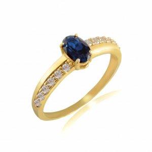 Γυναικείο δαχτυλίδι χρυσό 14Κ, με οβάλ μπλε ζιργκόν και λευκά ζιργκόν στη γάμπα, δεξιά κι αριστερά της κεντρικής πέτρας.