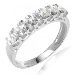 Δαχτυλίδι σειρέ λευκόχρυσο 14Κ σε λουστρέ επεξεργασία, διακοσμημένο με λευκά ζιργκόν.
