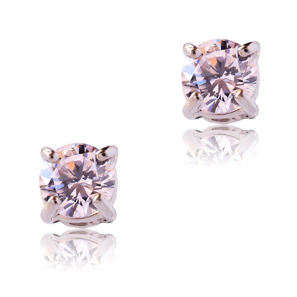Λευκόχρυσα σκουλαρίκια μονόπετρα 14Κ, διακοσμημένα με λευκές πέτρες ζιργκόν. Είναι δεμένα σε βάση με κωνικό σχήμα και τέσσερα στηρίγματα. Έχουν διάμετρο 0.45 cm.