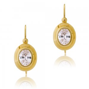 Κρεμαστά γυναικεία σκουλαρίκια από χρυσό 14Κ σε λείο λουστρέ φινίρισμα. Έχουν οβάλ σχήμα και είναι διακοσμημένα με λευκές πέτρες ζιρκόν.
