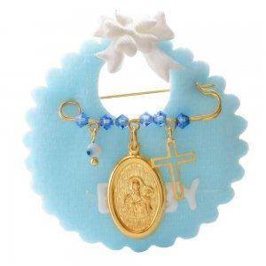 Ασημένια παιδική παραμάνα 925 επίχρυση πάνω σε γαλάζιο βελούδινο μαξιλαράκι. Είναι διακοσμημένη με οβάλ φυλαχτό με την Παναγία, ματάκι, σταυρουδάκι και γαλάζιες πέτρες.