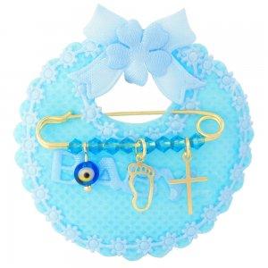 Παιδική παραμάνα ασήμι 925 επίχρυσο, πάνω σε γαλάζιο μαξιλαράκι σαλιάρα. Η παραμάνα για νεογέννητο αγόρι είναι διακοσμημένη με ματάκι, σταυρουδάκι, πατούσα και γαλάζιες πέτρες.