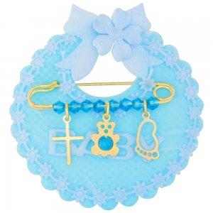 Παιδική παραμάνα για νεογέννητο ασημένια 925, επιχρυσωμένη, πάνω σε γαλάζιο μαξιλαράκι σαλιάρα. Η παραμάνα για νεογέννητο αγόρι είναι διακοσμημένη με διακριτικό σταυρό, αρκουδάκι, διάτρητη πατούσα και γαλάζιες πέτρες.